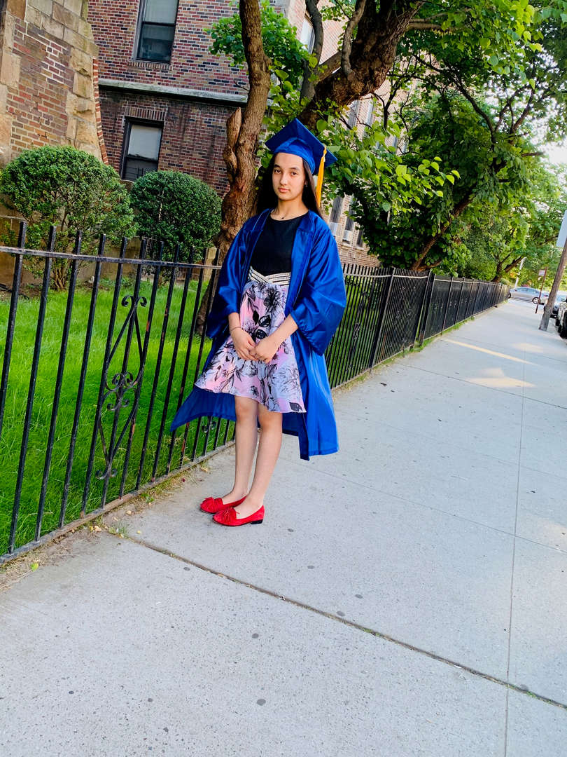 Graduate wearing red shoes