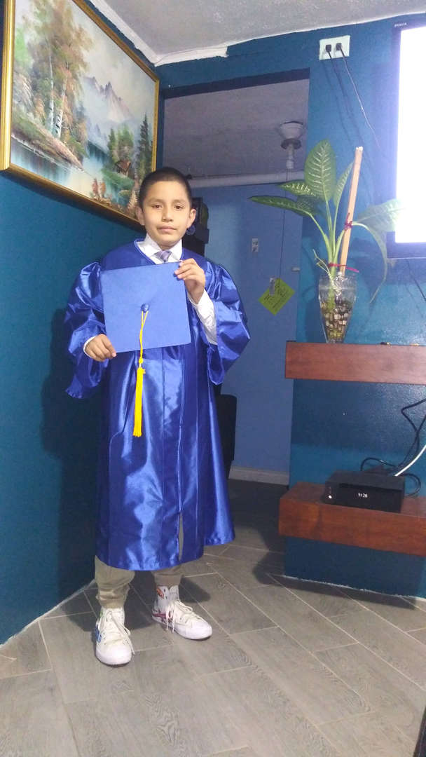 Graduate in front of blue wall