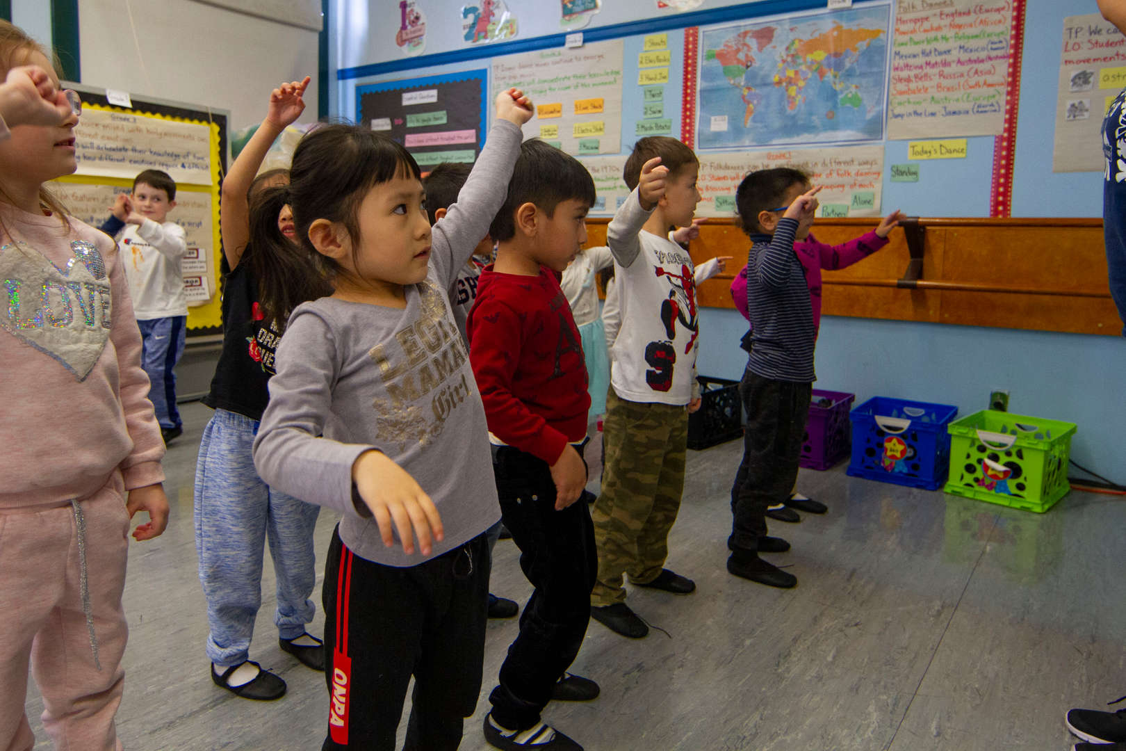 Students moving together in dance class