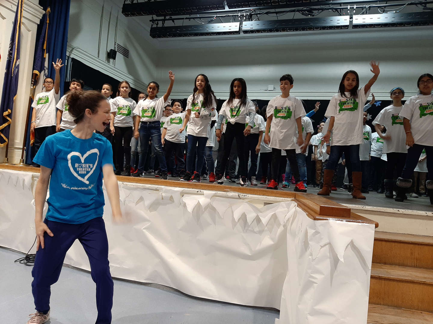 Rosie's Theater Kids leader guides students in dance