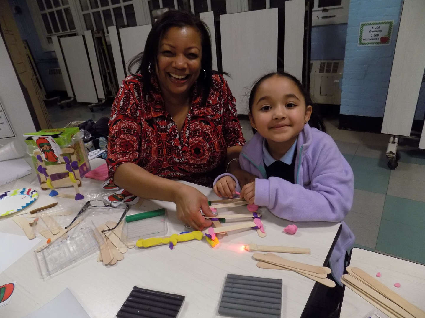 Mother and daughter smiling during STEAM family fun night