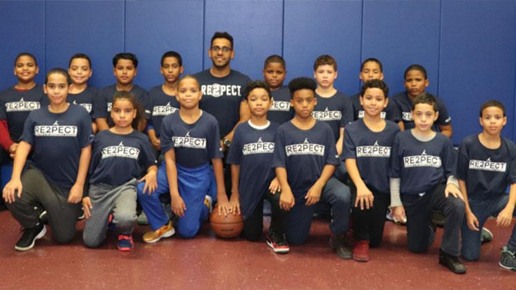 The boys' basketball team and their coach