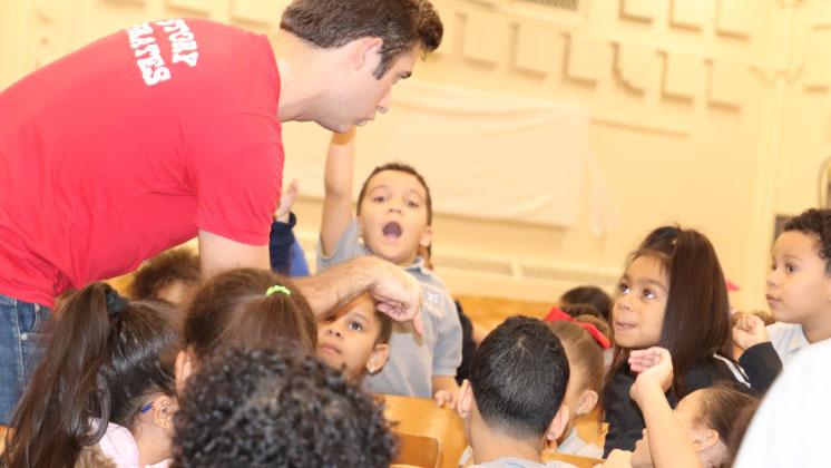 Story Pirates Residency: Students listen to teacher speak