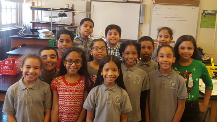 Students standing together in a classroom