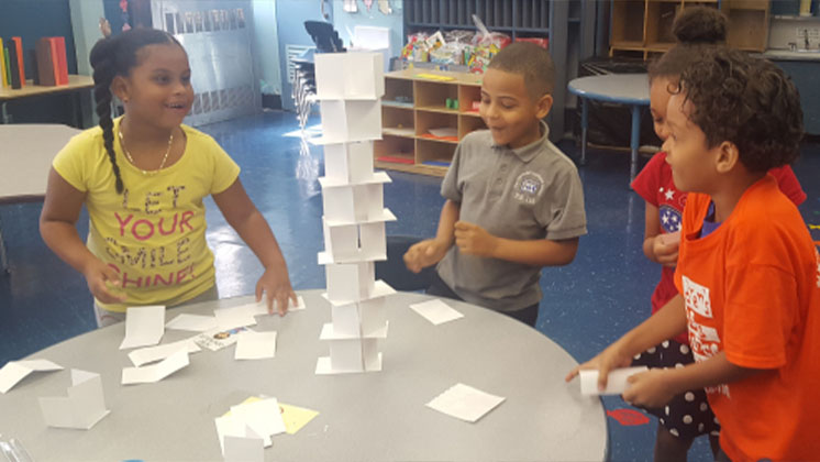 Students building a structure out of paper