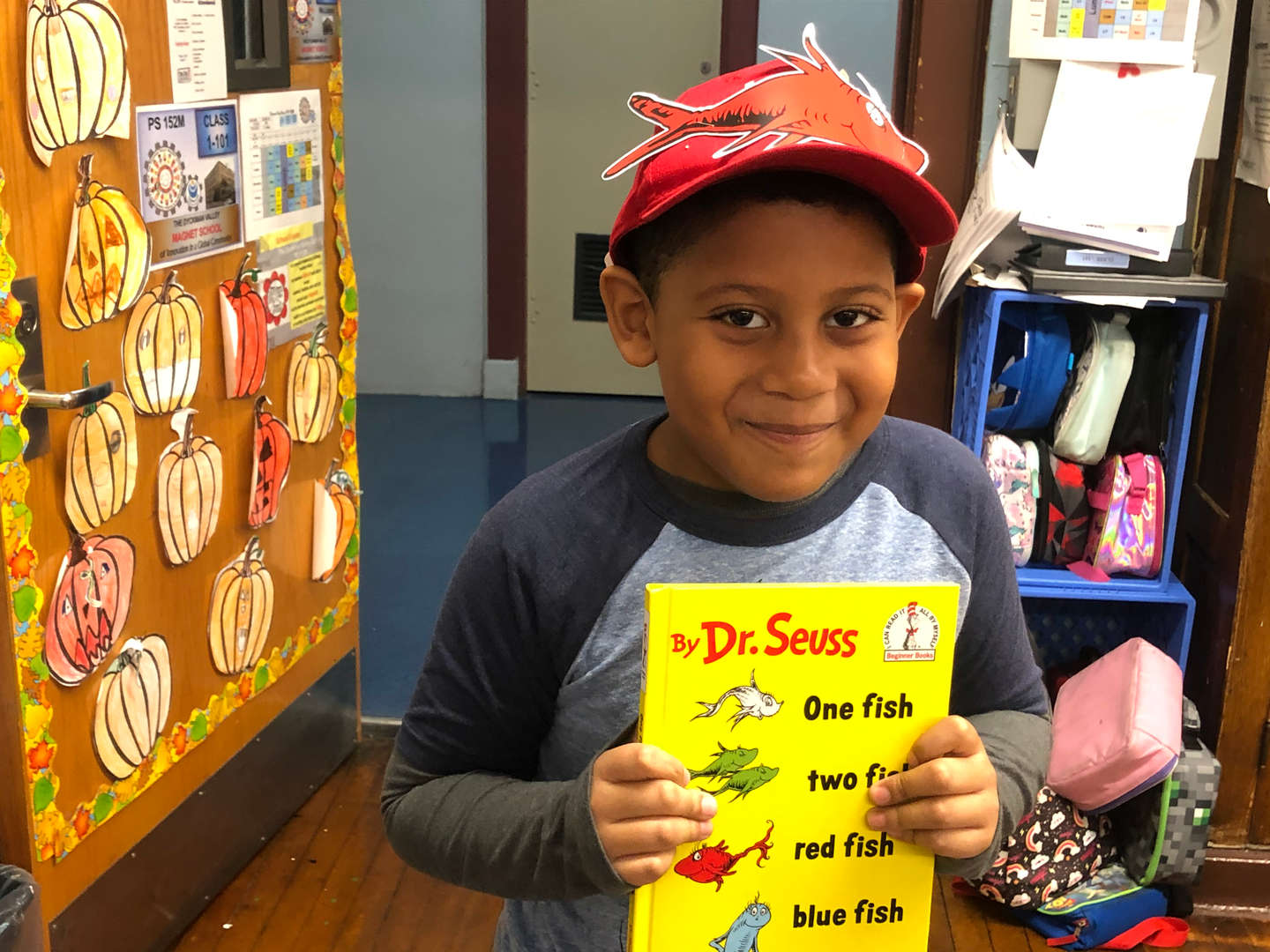 Student holding Dr. Seuss book