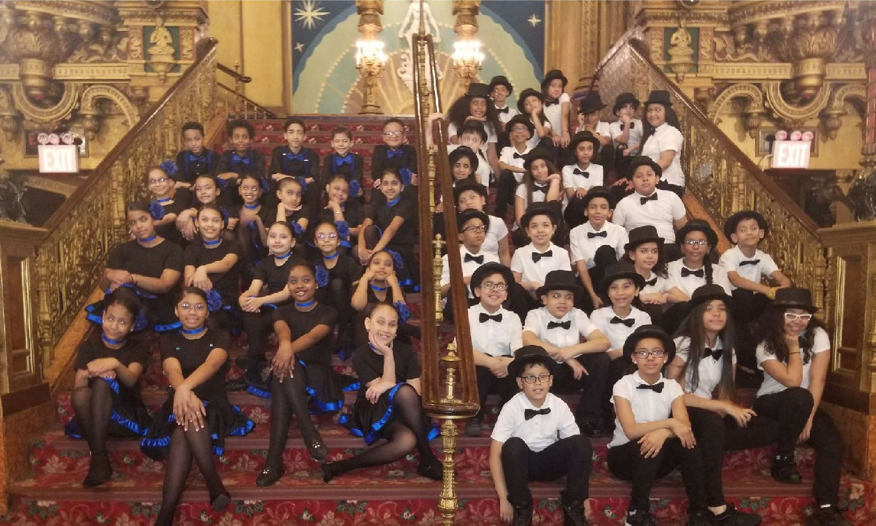 The two ballroom dancing teams dressed for a show