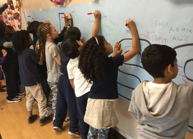 Students Writing on Board