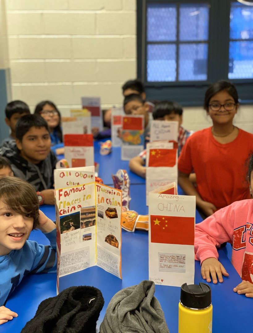 Students showing their China brochures.