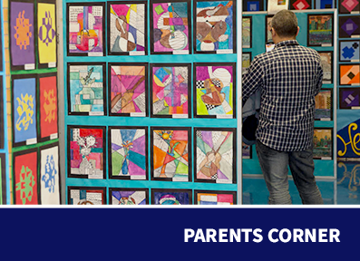 Parents Corner: Parent looking at student art pieces