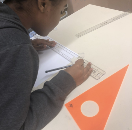 Student working on her architectural drawing