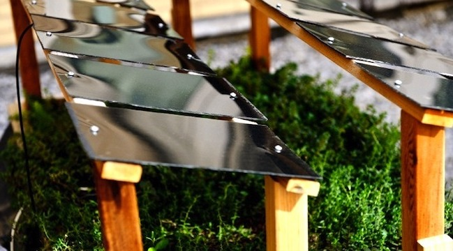 Two rows of solar panels outdoors