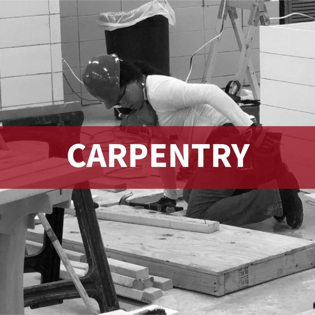Carpentry: student with hardhat on