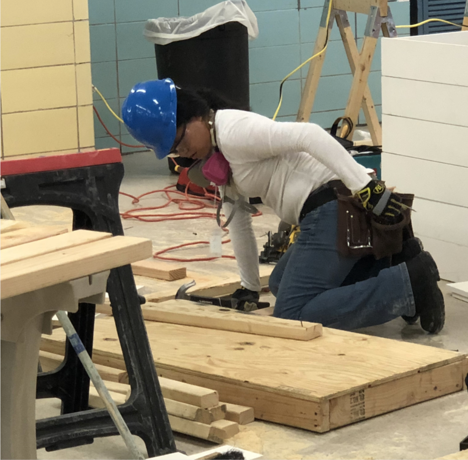 Girl working on her carpentry project