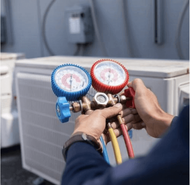 Hands adjusting HVAC pressure switches