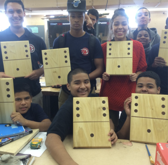 Students showing off their wood pieces
