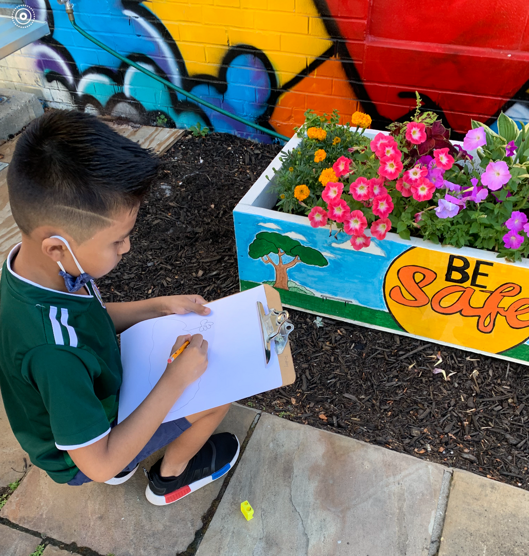 student drawing flowers