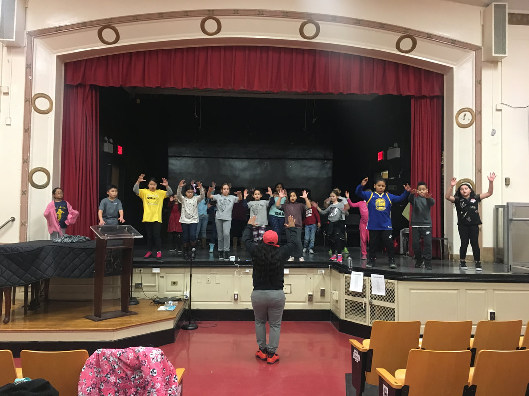 Students standing on stage