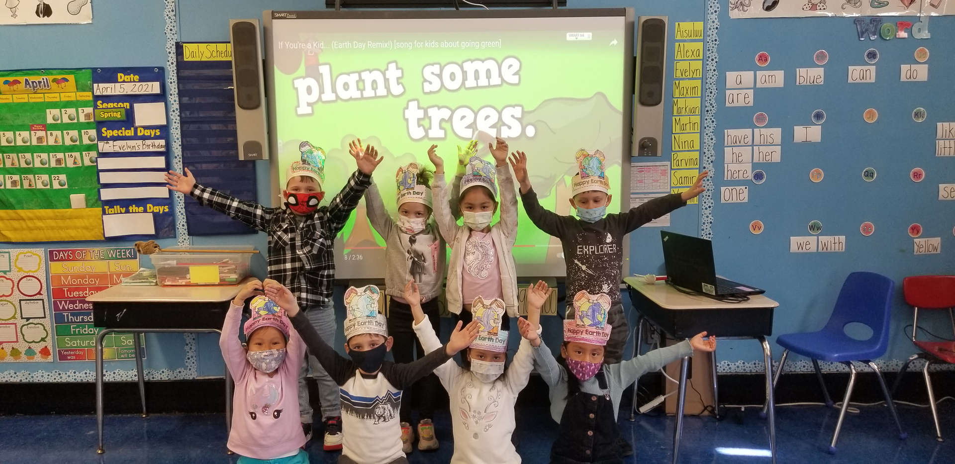 Early elementary school students celebrating Earth Day.