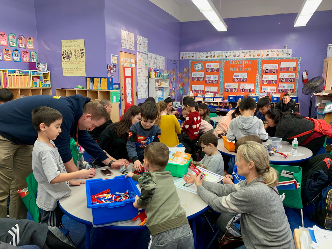Students and teachers doing crafts in the classroom