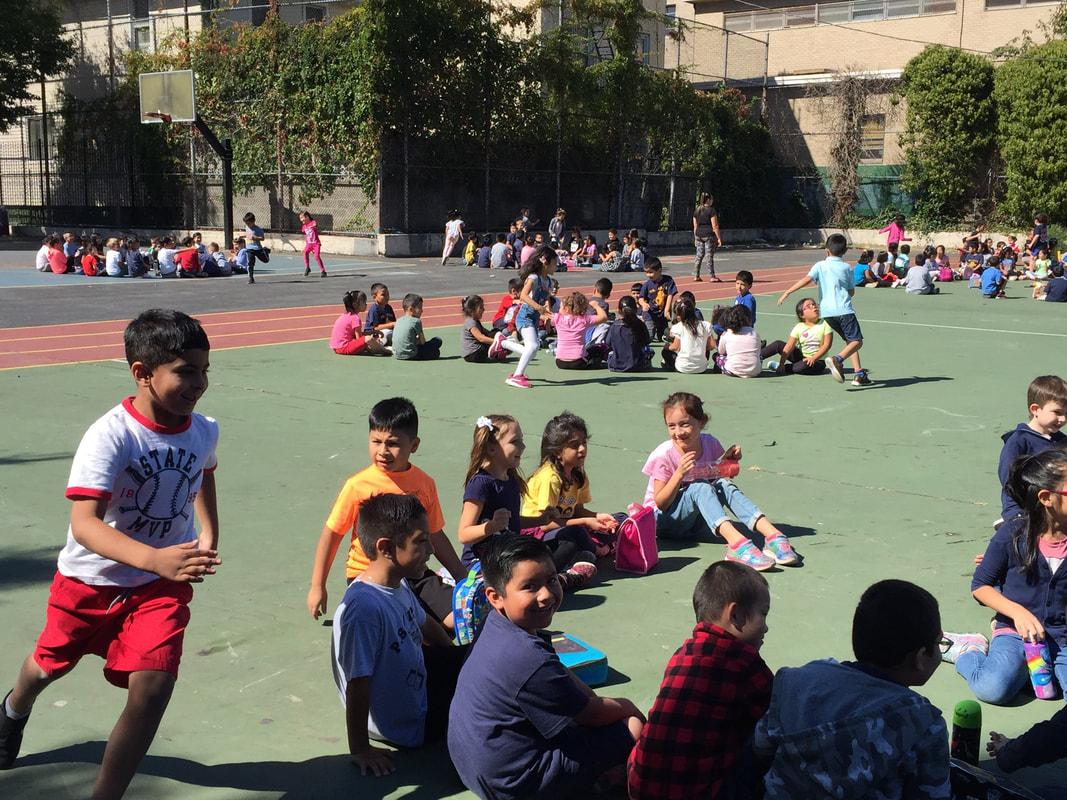Kids running around in the playground
