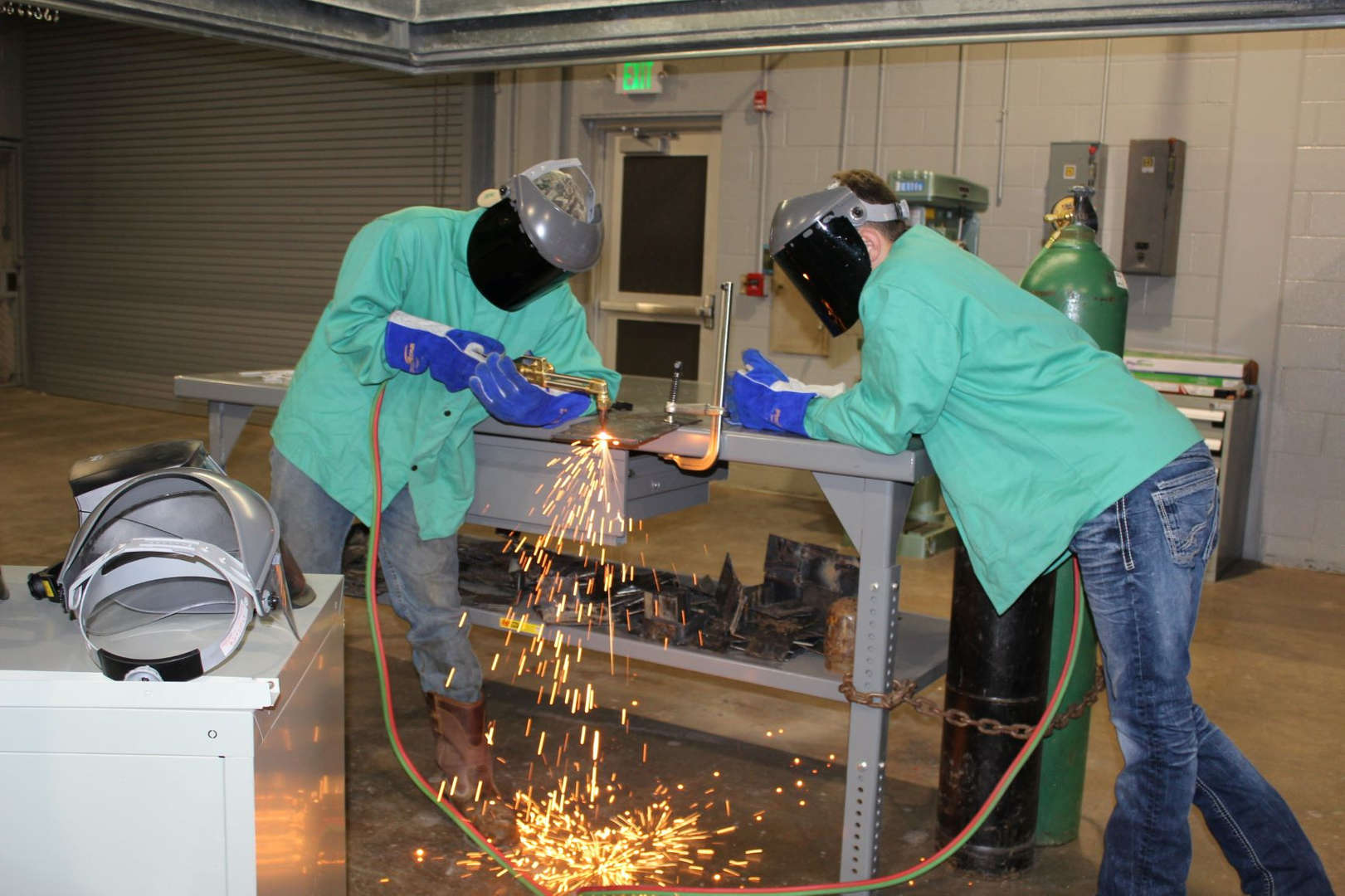 Students at work in welding class.