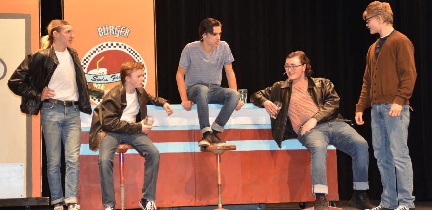 Students performing during a play.