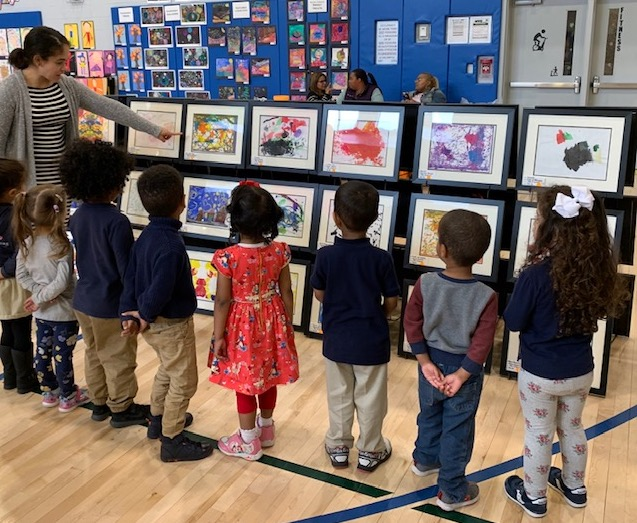 Kids appreciating art at a show