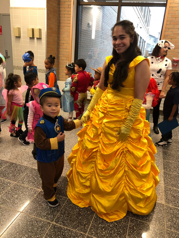 Woman dressed as Belle with student in Paw Patrol costume