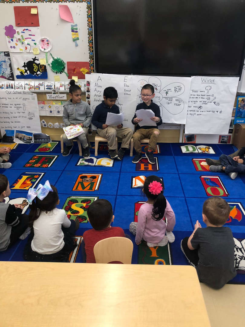 1st Graders sharing their poems with Pre-K students