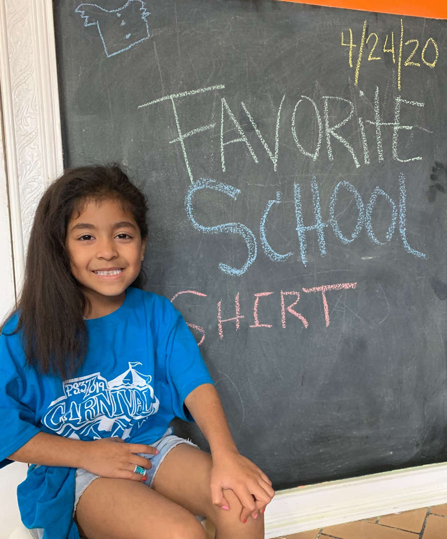Student wearing her favorite P.S. 377 shirt.