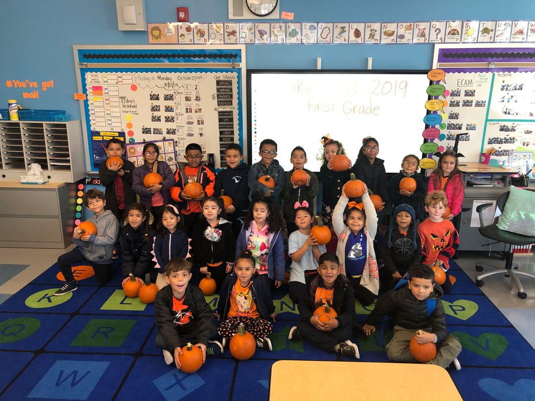 Students gathered in classroom with their pumpkins