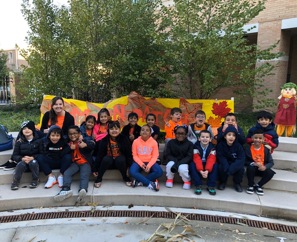 Students in front of the pumpkin parade sign
