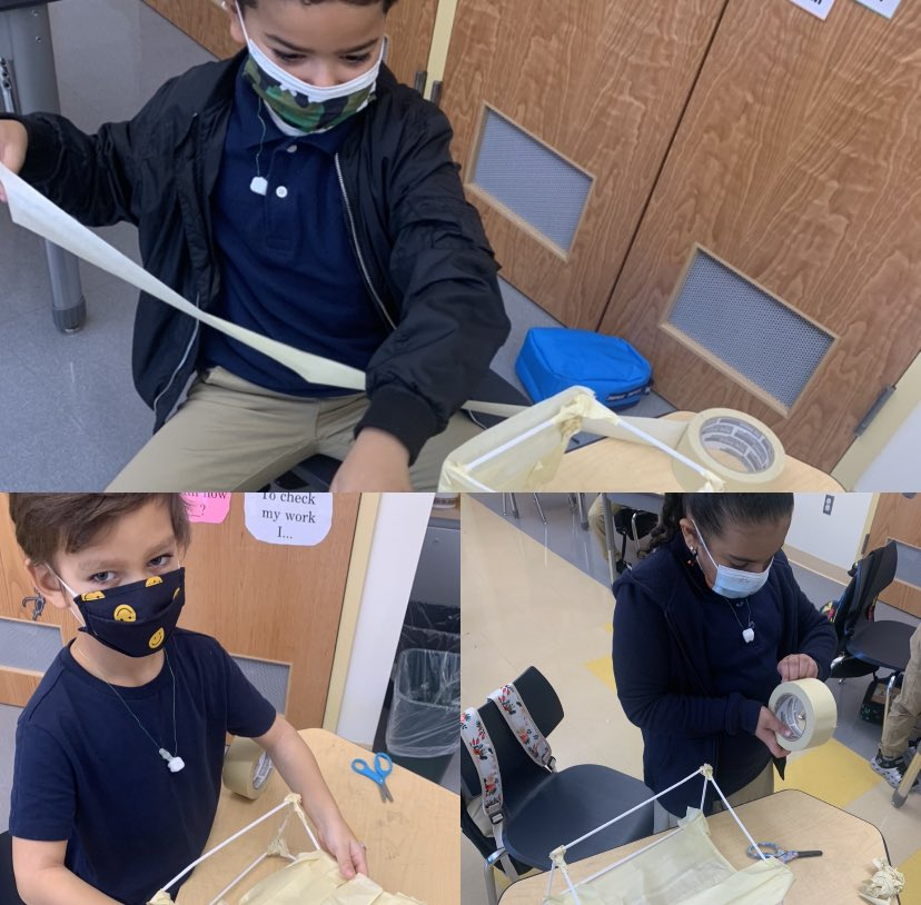 students building something out of straws and tape
