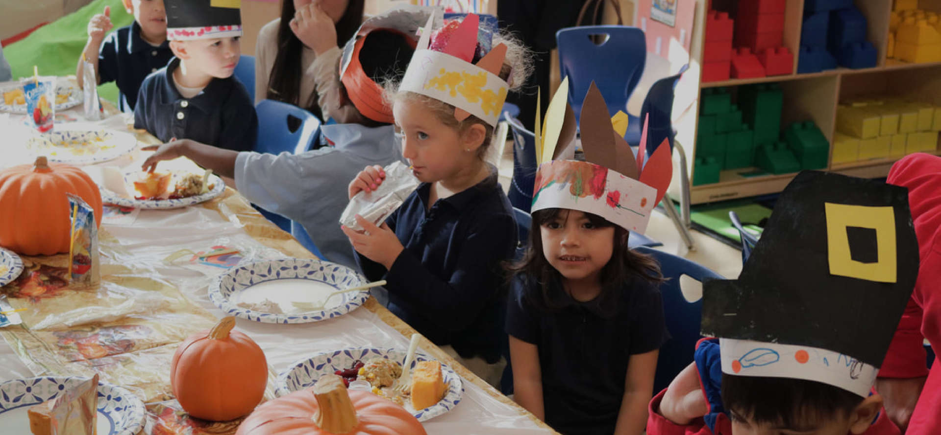Students wearing their Thanksgiving crafts