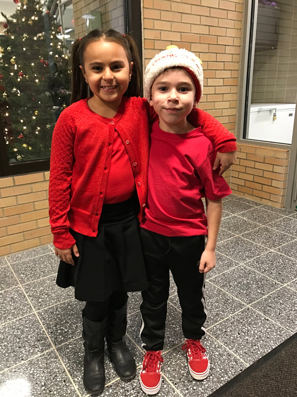 Girl and boy dressed in holiday concert outfits