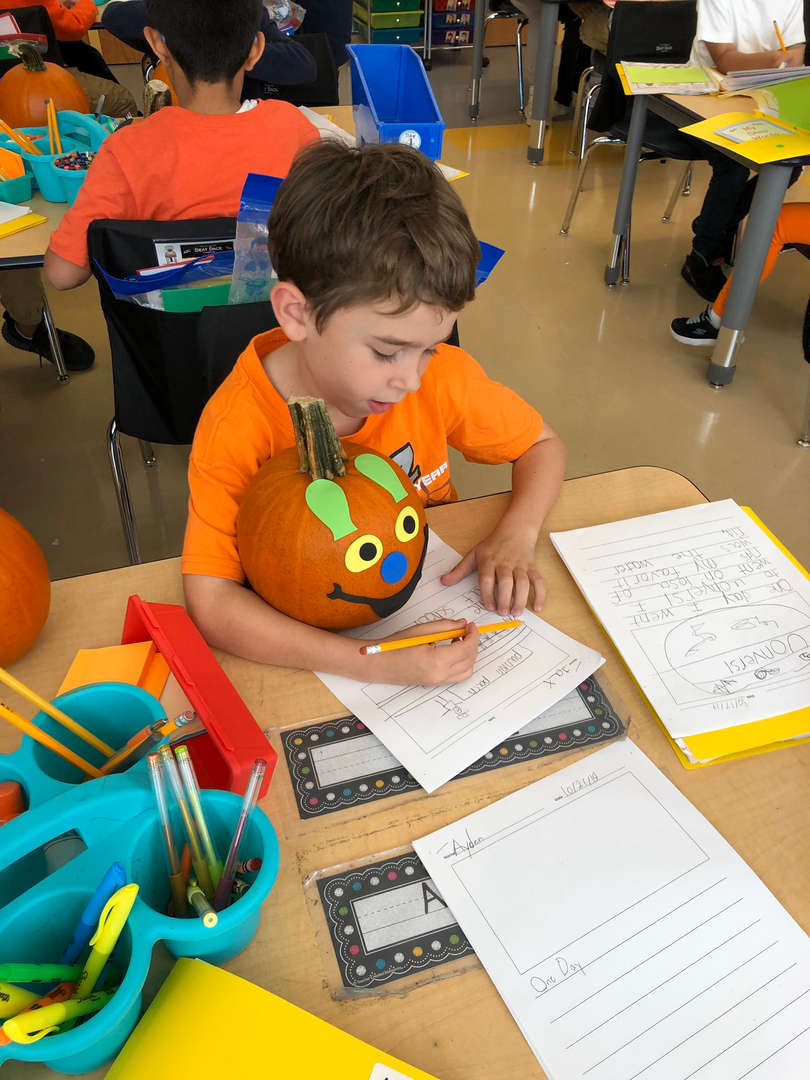 Student writing about his pumpkin