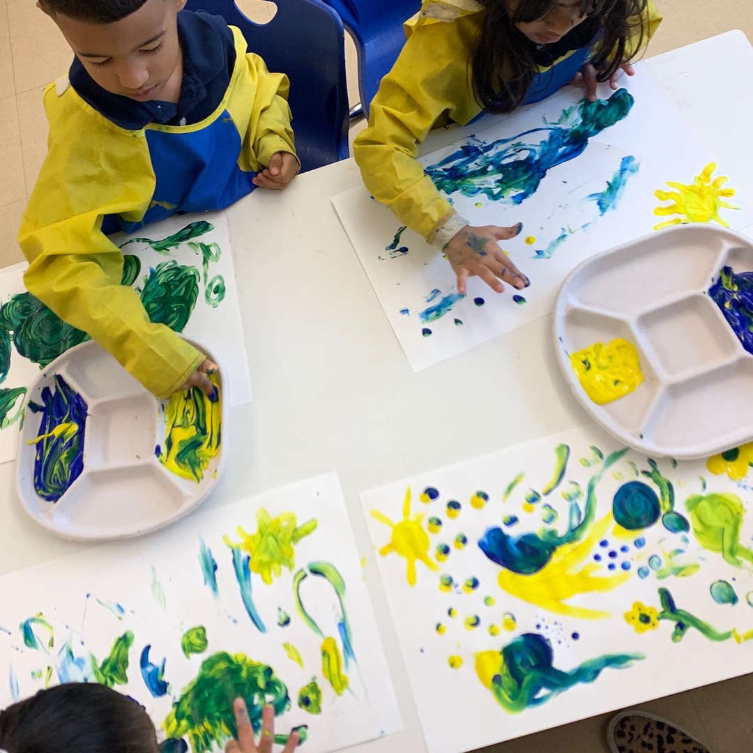 Students painting with their hands