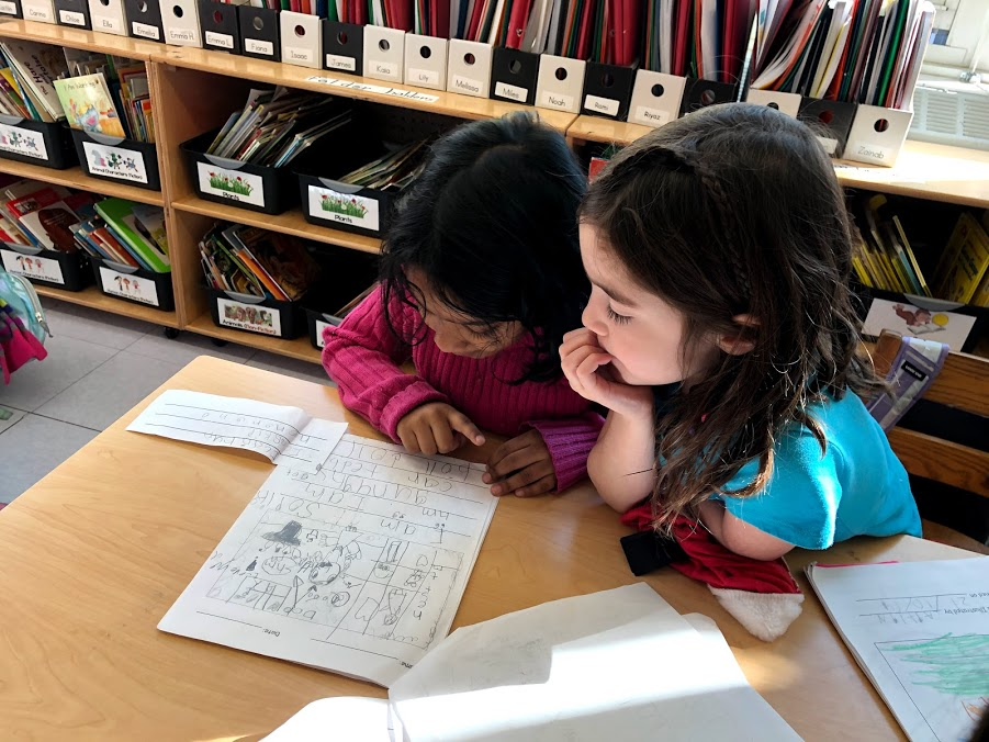 Two girls working on worksheets together