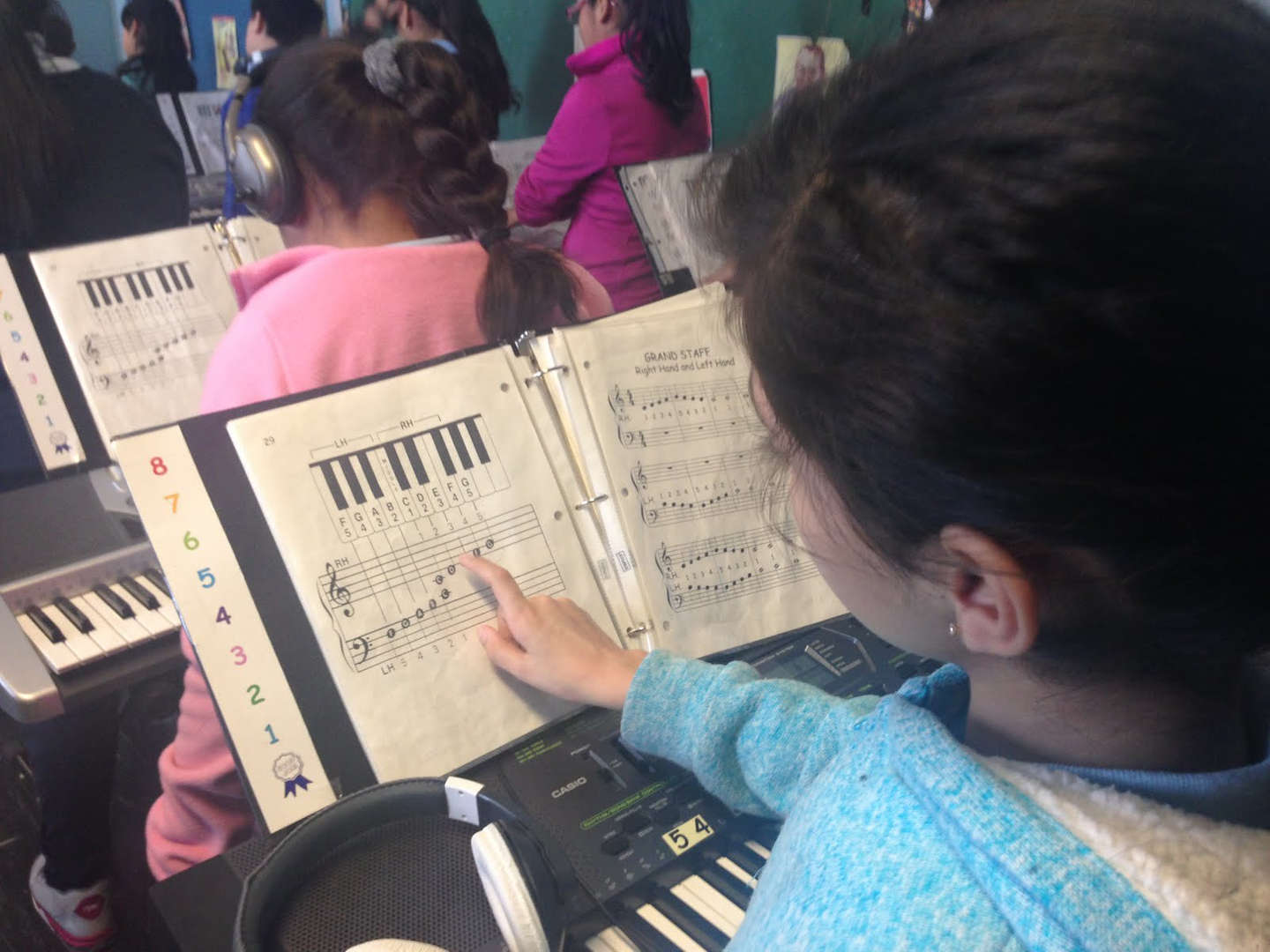 Student pointing to sheet music in class