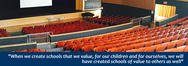 "An auditorium: ""When we create schools that we value, for our children, and for ourselves, we will have created schools of value to others as well."""