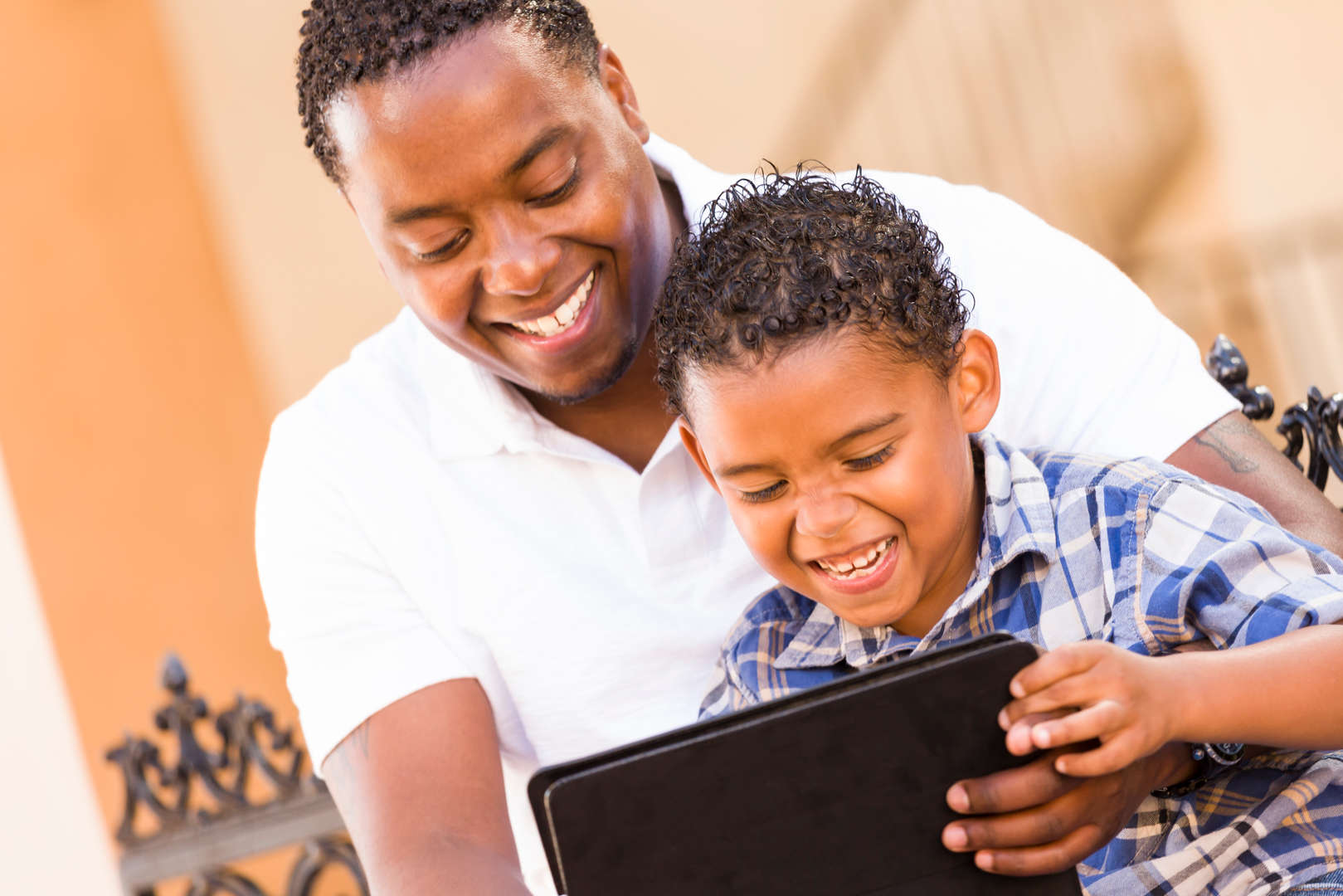 Parent and child on tablet together
