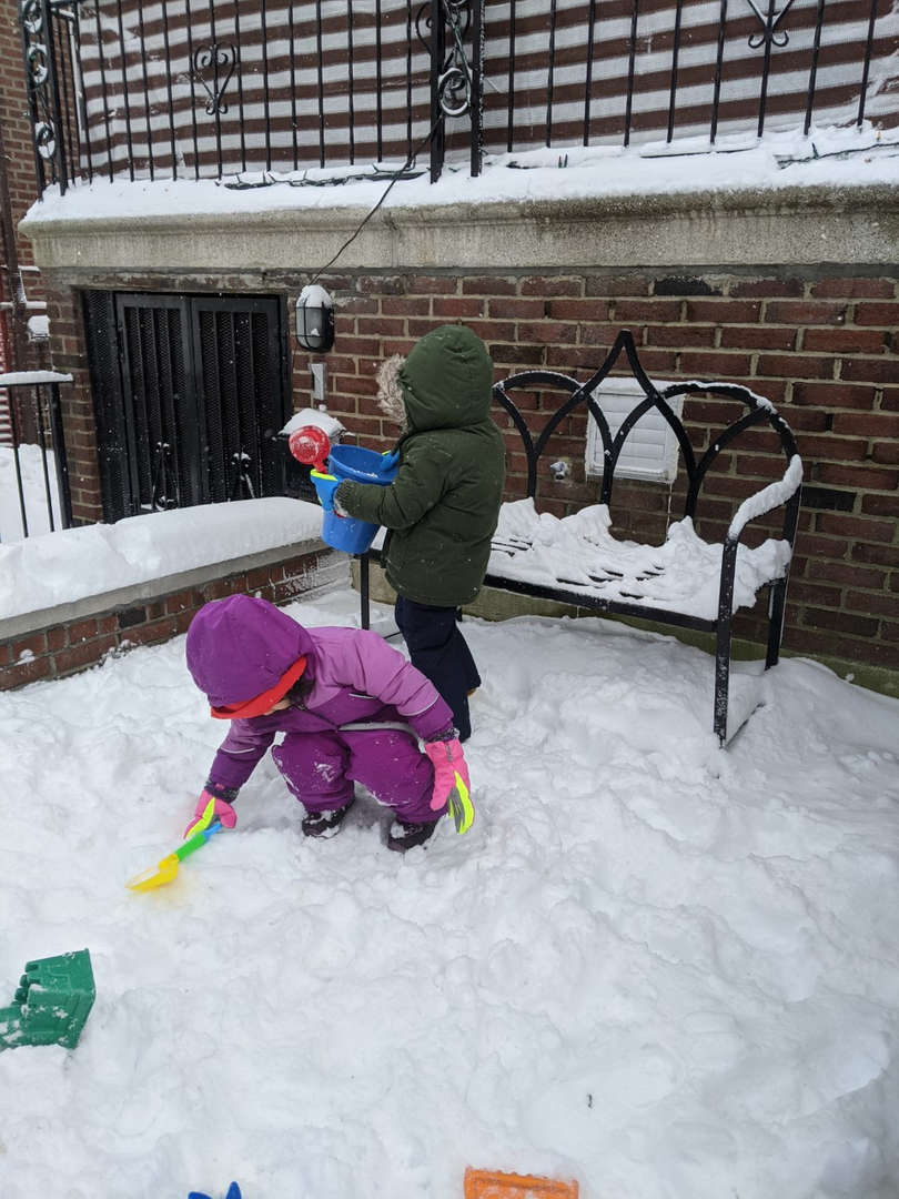 two kids playing in the snow
