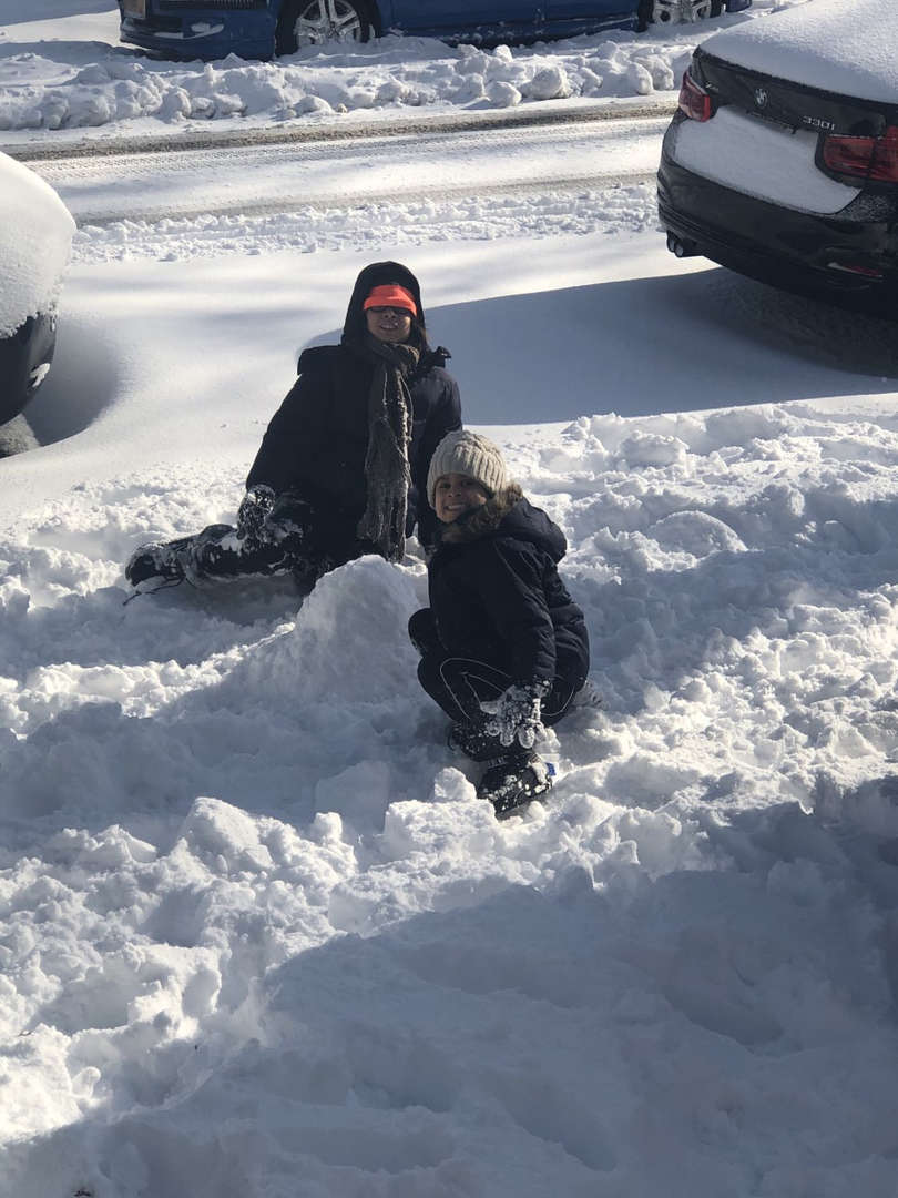 two kids with snow having fun