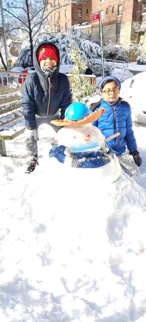 a snowman with a blue hat