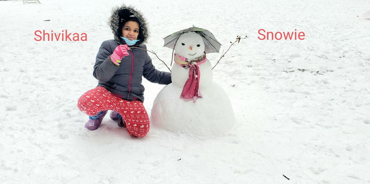 a girl with a snowman named snowie