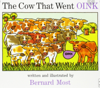 book cover with cows and pig