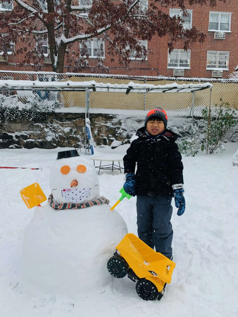 a big snowman with a boy