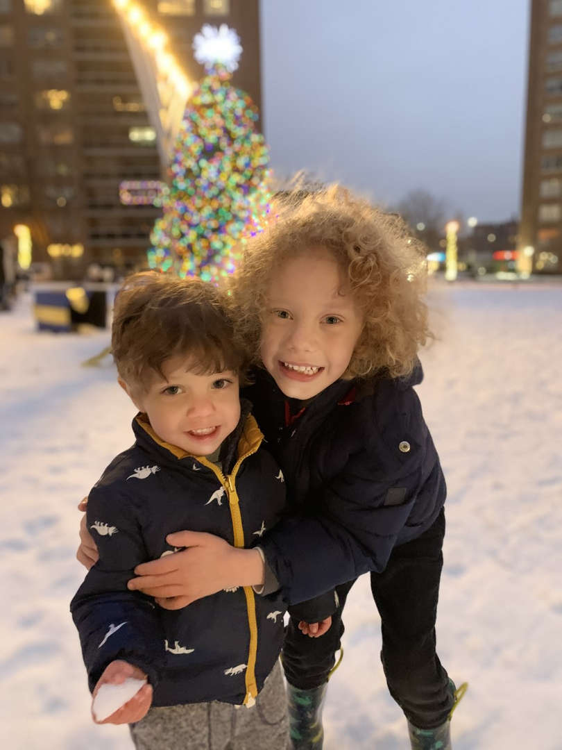 two kids smiling in the snow