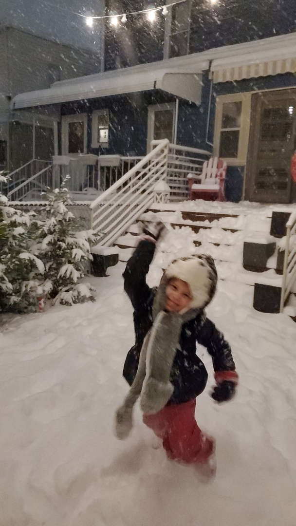 a girl trying to throw a snowball